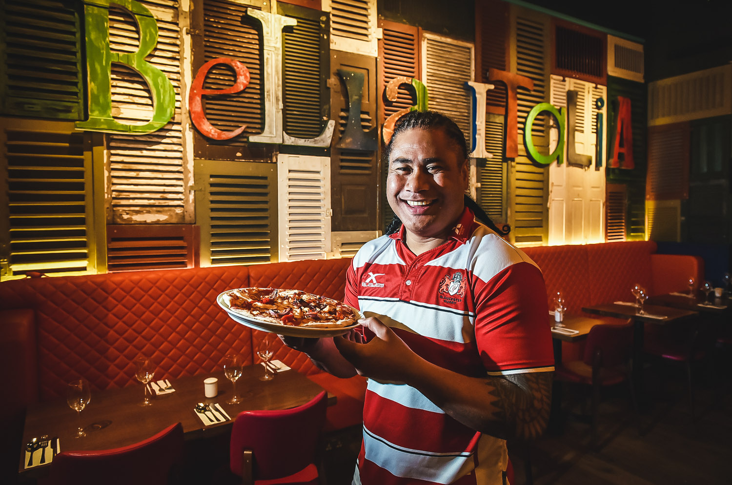 corporate publicity shot of gloucester rugby player in Bella Italia