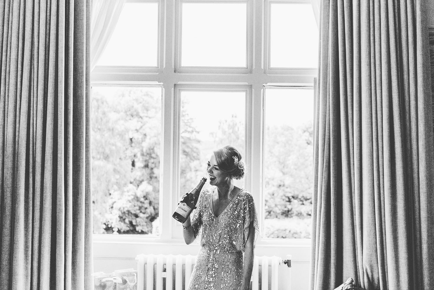 bridesmaid-with-a-bottle-of-champagne.jpg