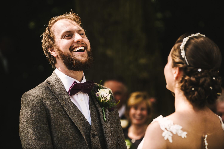 laughing-groom-bibury-outdoor-wedding.jpg