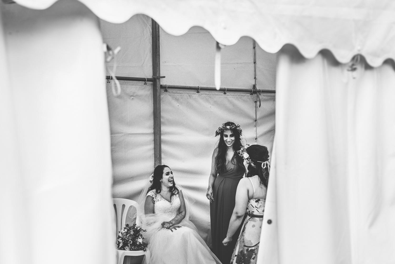 bride-laughs-bridesmaids-jewish-wedding.jpg