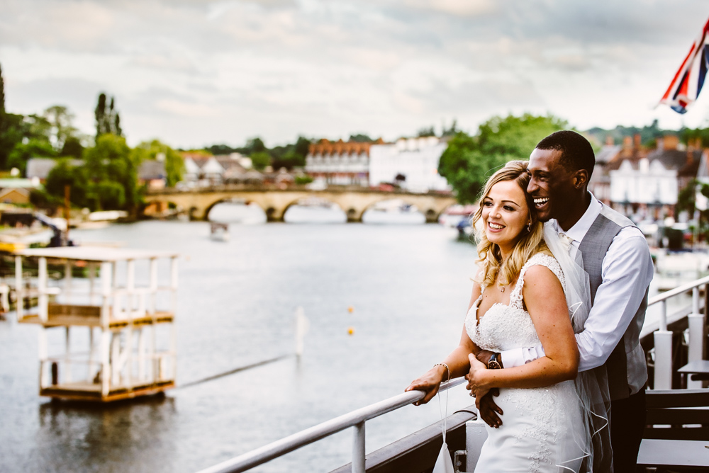 couple embrace above the river thames
