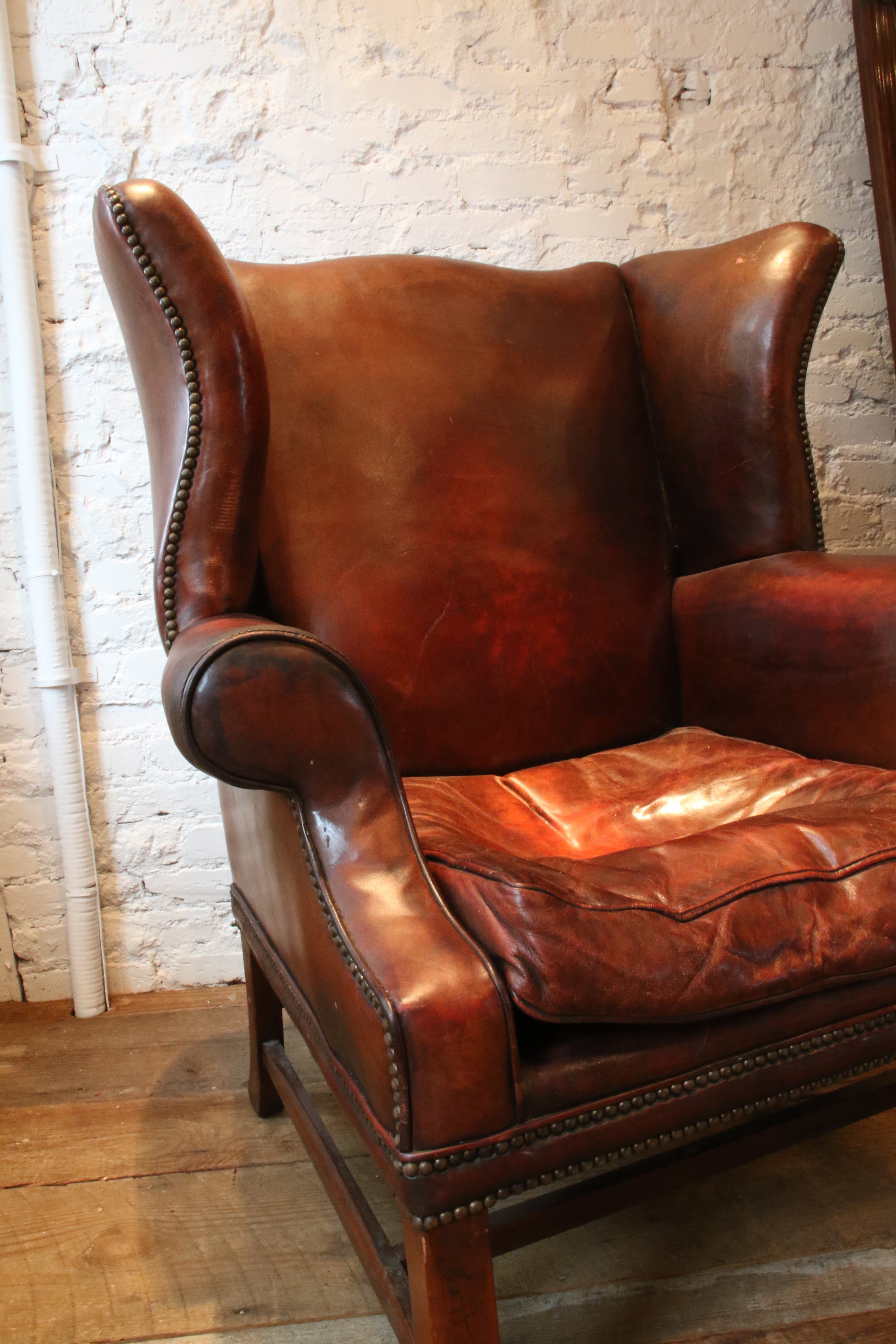 "Antique Patinated Leather Chair, Original Upholstery   42"" H x 24"" D x 33"" W  $8000   To order please call us at 202-234-5926 or email at boutique@darrylcarter.com. Please note pricing excludes taxes and shipping."