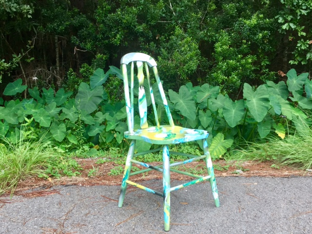 This antique, solid wood fiddleback chair has been hand-painted with waterlilies from the marshes of Southeast Louisiana. It will be auctioned off on August 26 to raise funds for the Louisiana Children's Museum.