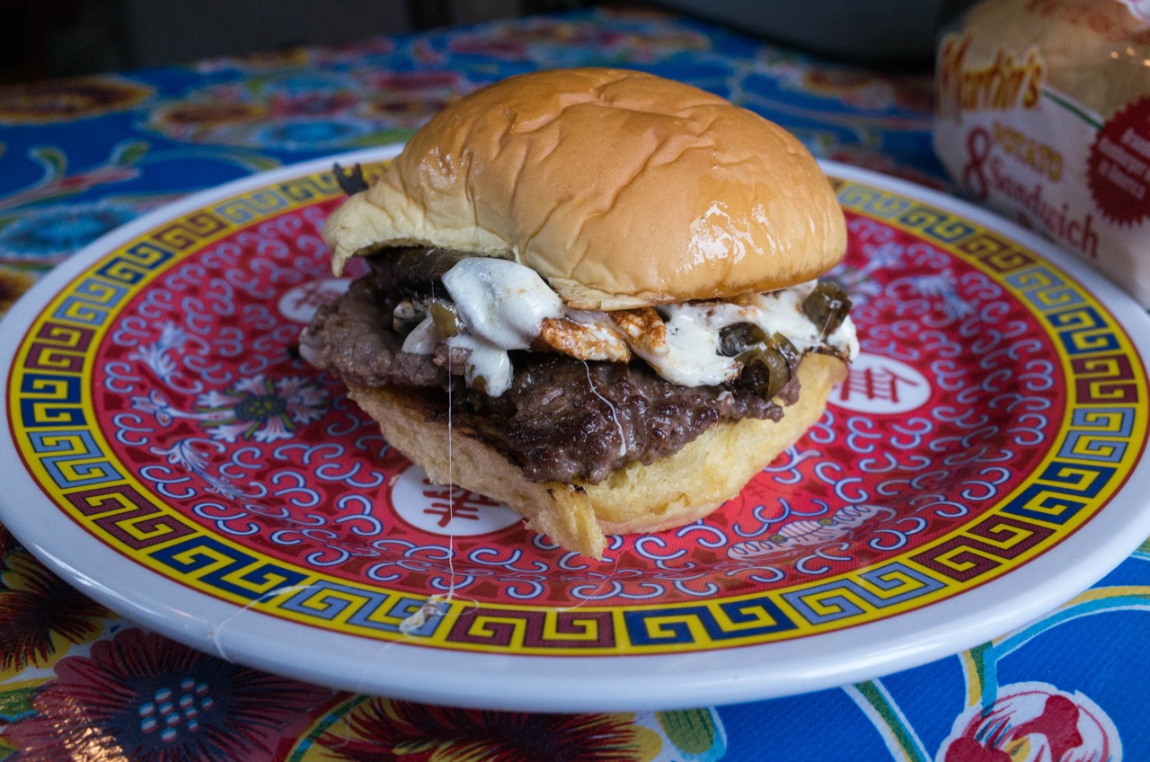 A nearby Mexican grocery store sold me a giant bag of melty Mexican cheese that I had to figure out what to do with. So here's a cheeseburger I made topped with a pickled Thai pepper quesillo. I pickled those peppers myself, too!