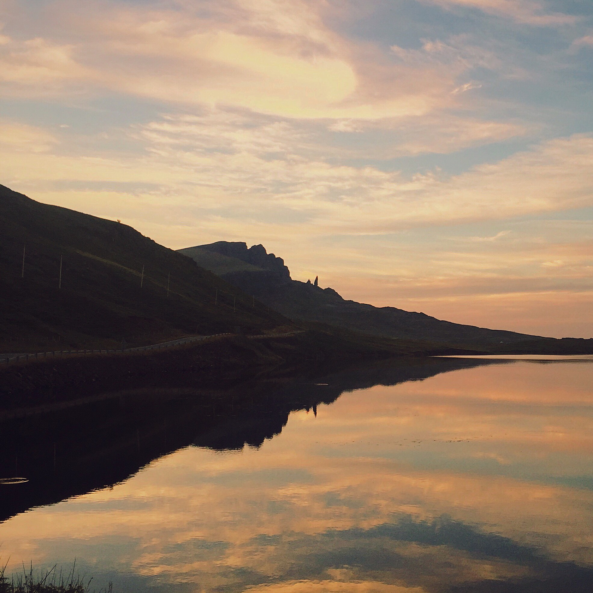 iPhone 6, Isle of Skye  The use of the water and the sky help provide balance and create some beautiful symmetry.
