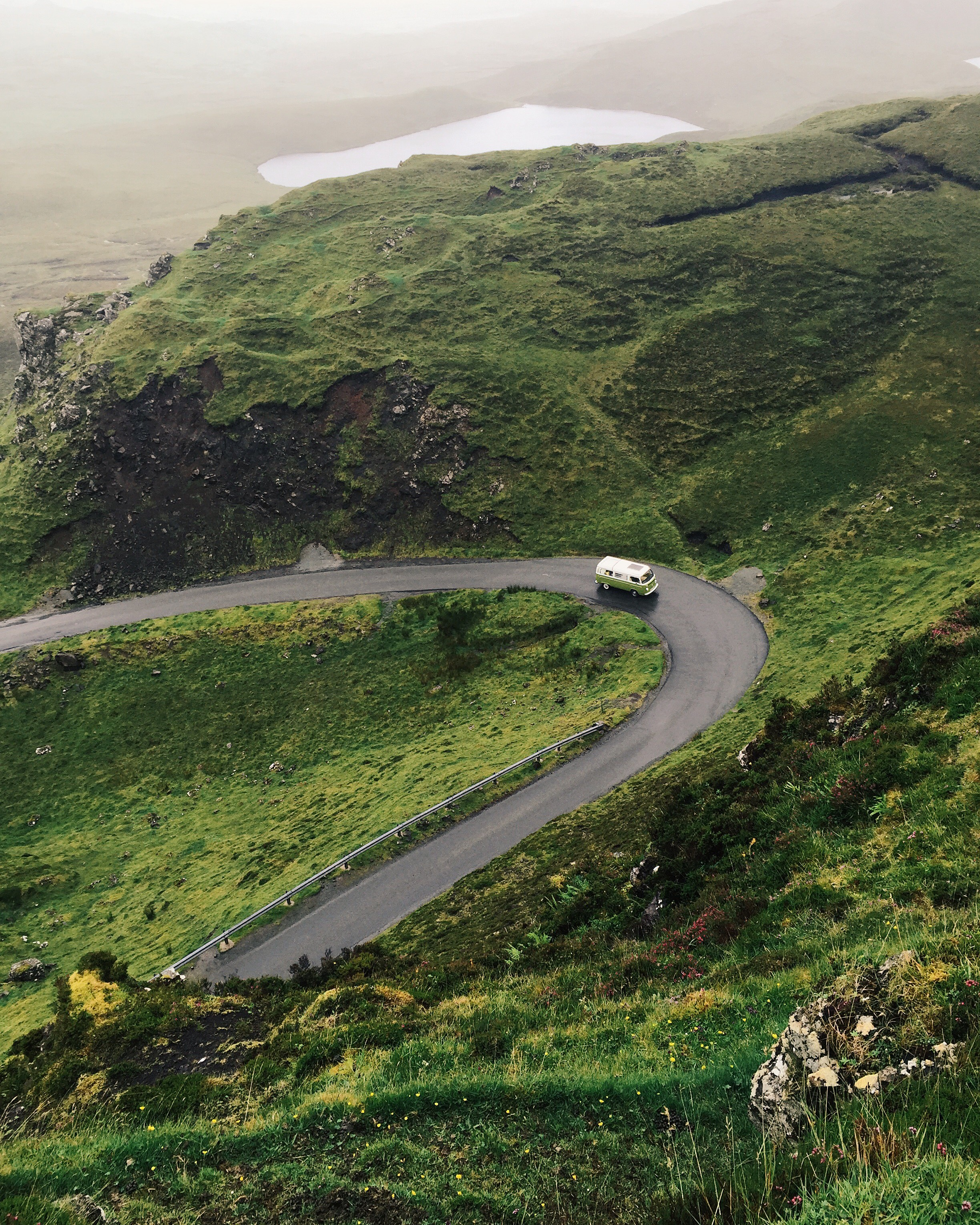 This is the famous Quirang Road on the isle of Skye. It's been photographed many, many times. I wanted to put my own stamp on it so climbed up and shot down. It helps that l have a very photographic camper van and a willing husband to my photography adventures.  iPhone 6
