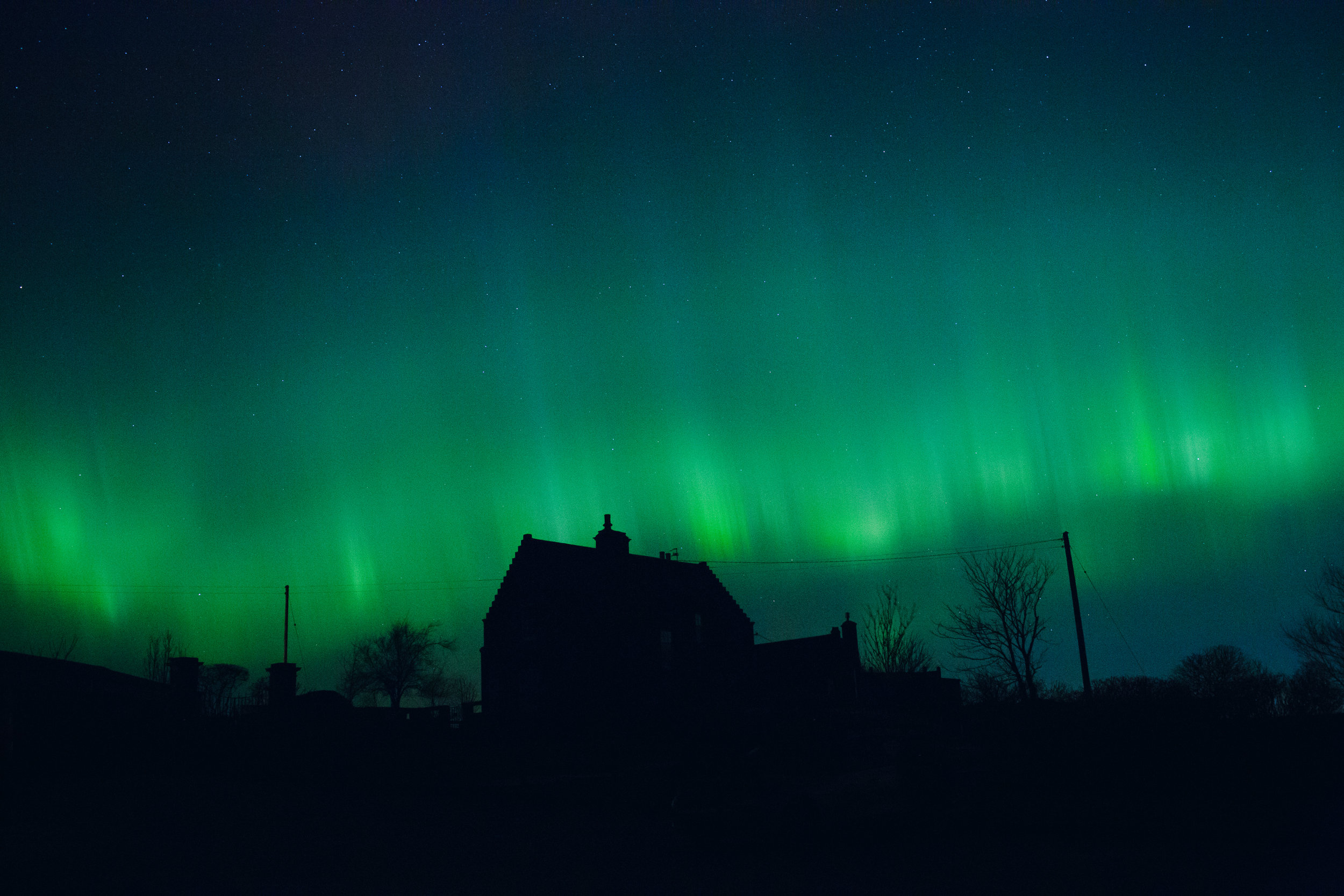 Watching the northern lights (the local term for Aurora Borealis) bouncing across the wide open skies in Aberdeen.