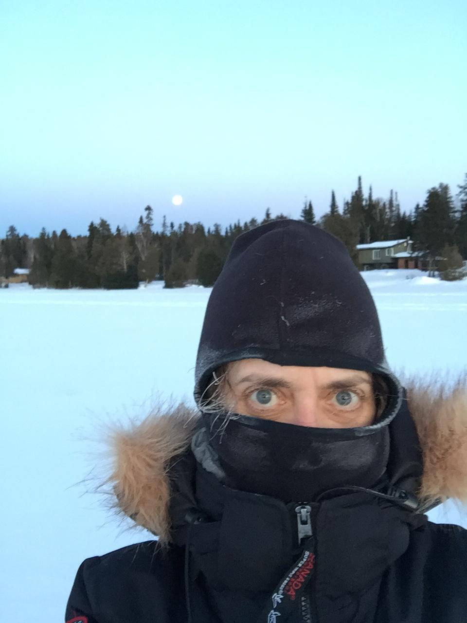 full moon rising over frozen lake — with Amanta Scott