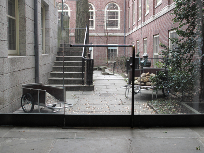 Installation view of the carts from the glass passageway
