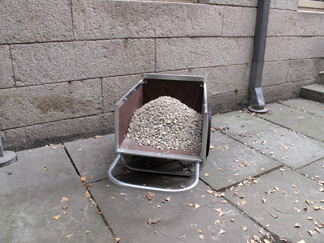 Detail of smaller cart with pea gravel