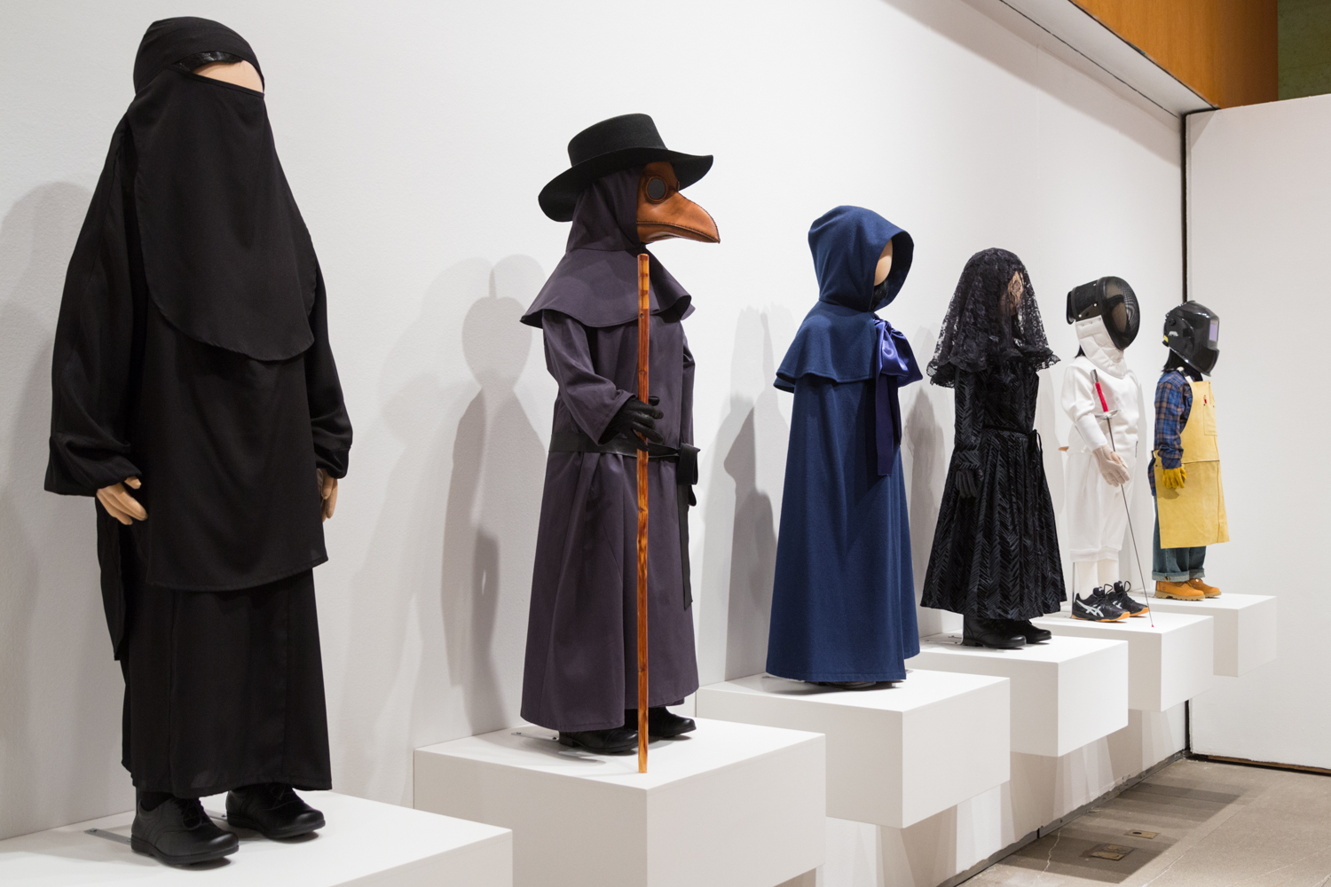 """Installation view of the """"Uniforms"""" figures at the Laurie M. Tisch Gallery in New York, 2016"""