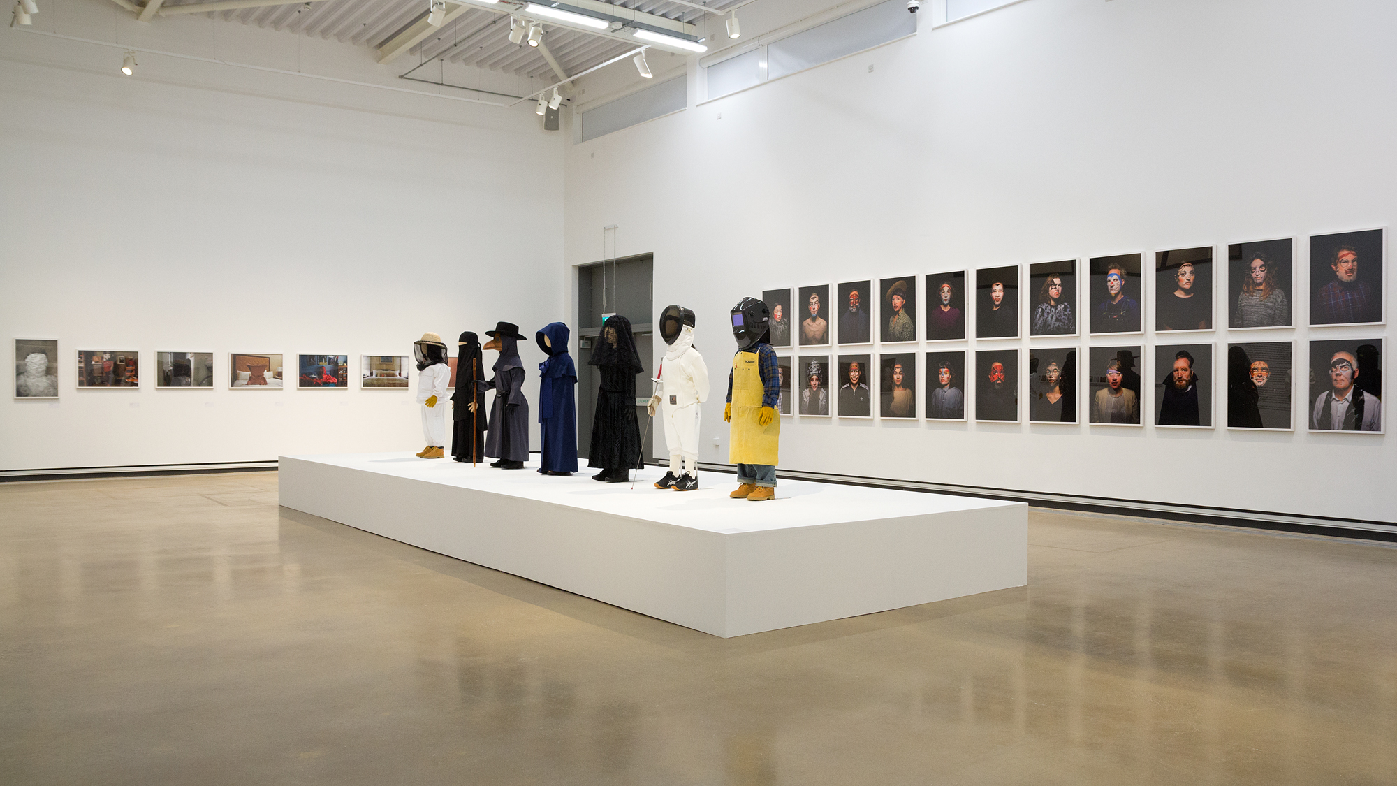 Installation view of Anti-Self-Portraits (2005 - 2008), Uniforms (2015), and Beauty (2017)