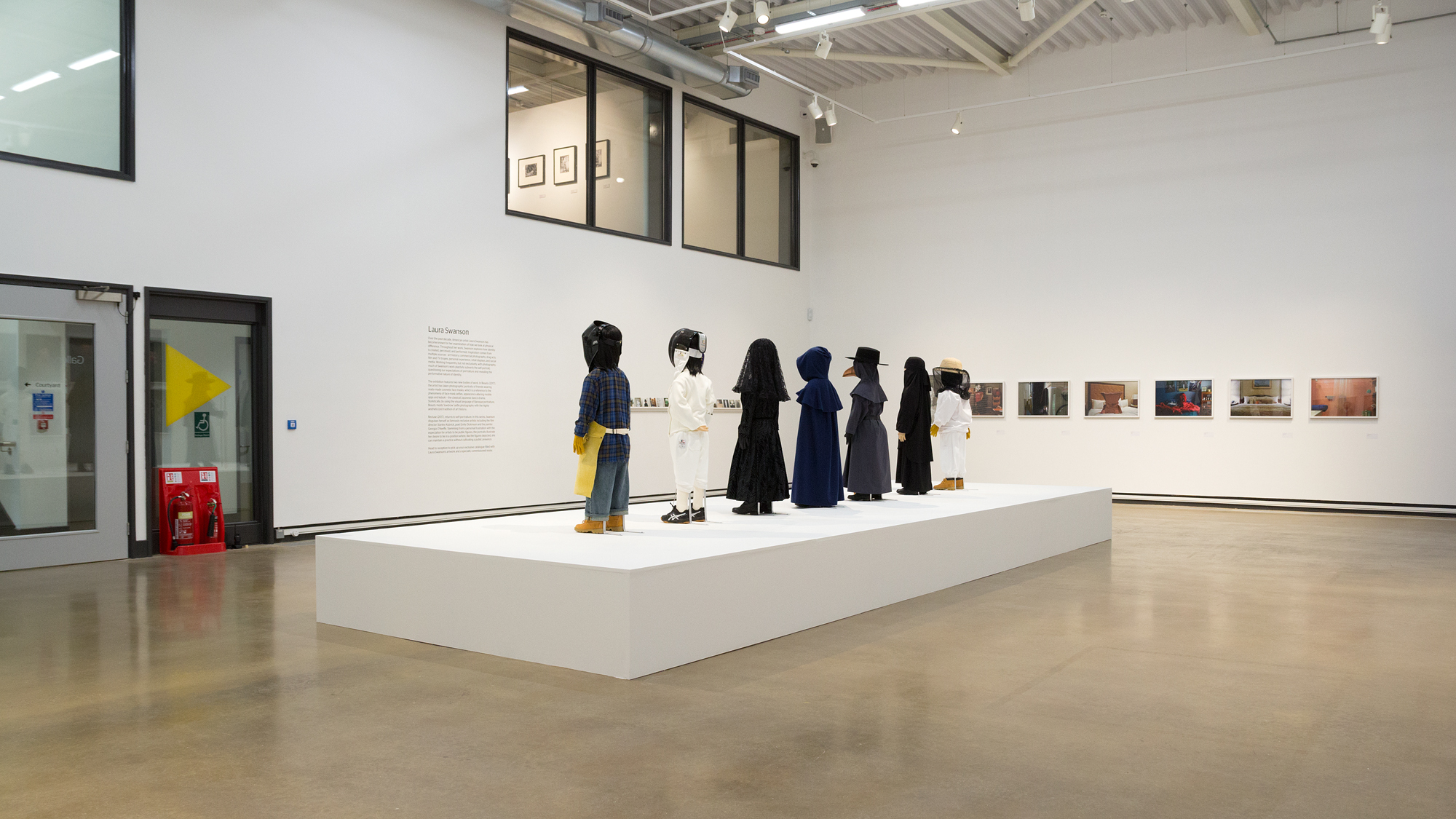 Installation view of Uniforms (2015) and Anti-Self-Portraits (2005-2008)