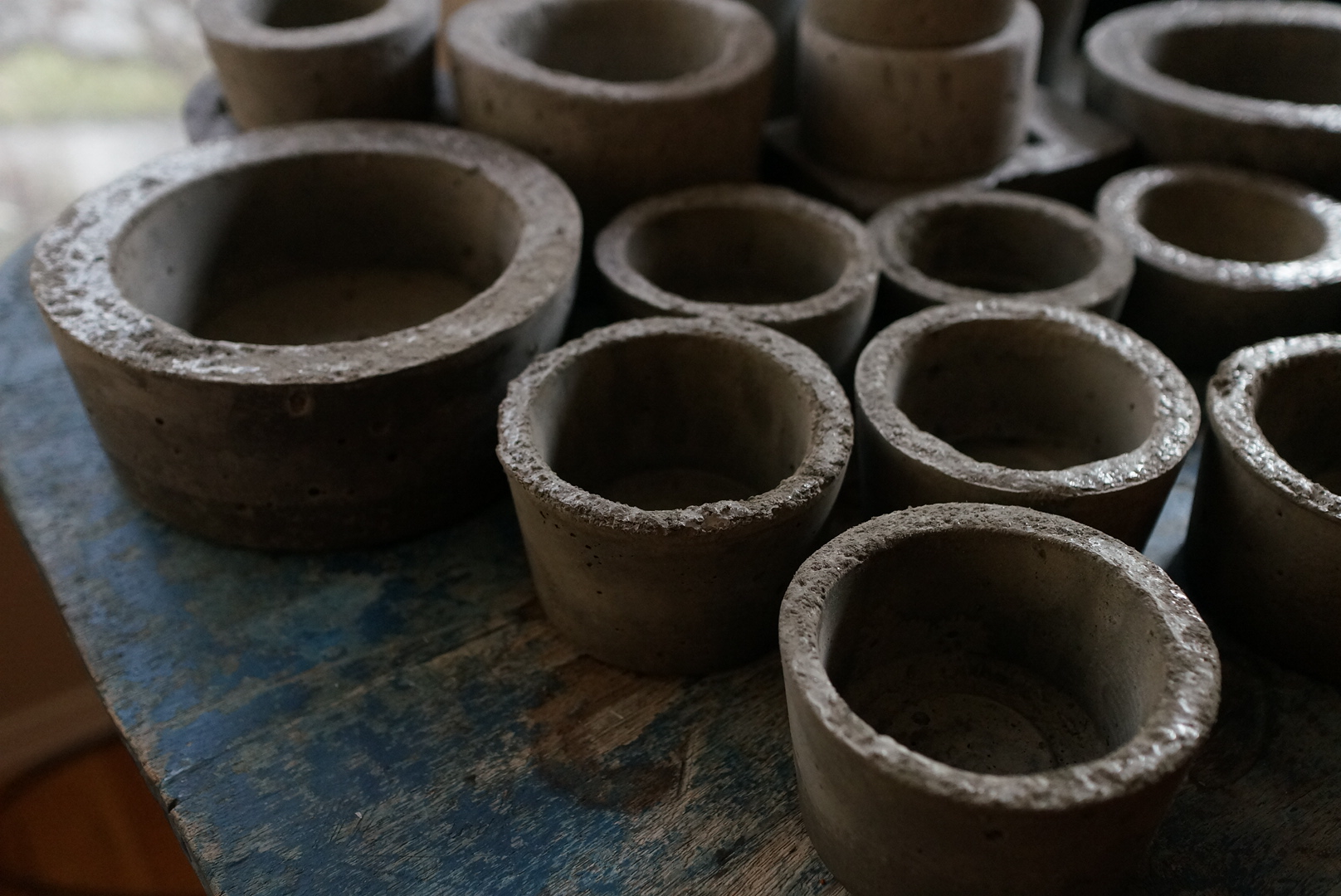 Concrete pots come out of their molds to dry.