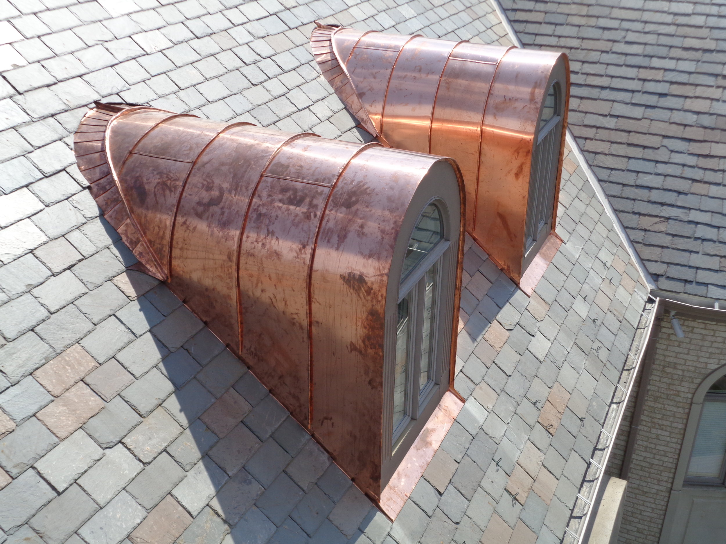 Barrel Dormers - With continuous pleated valley pieces and hand seamed 20 ounce copper panels. Pittsburgh, PA (June 2017).