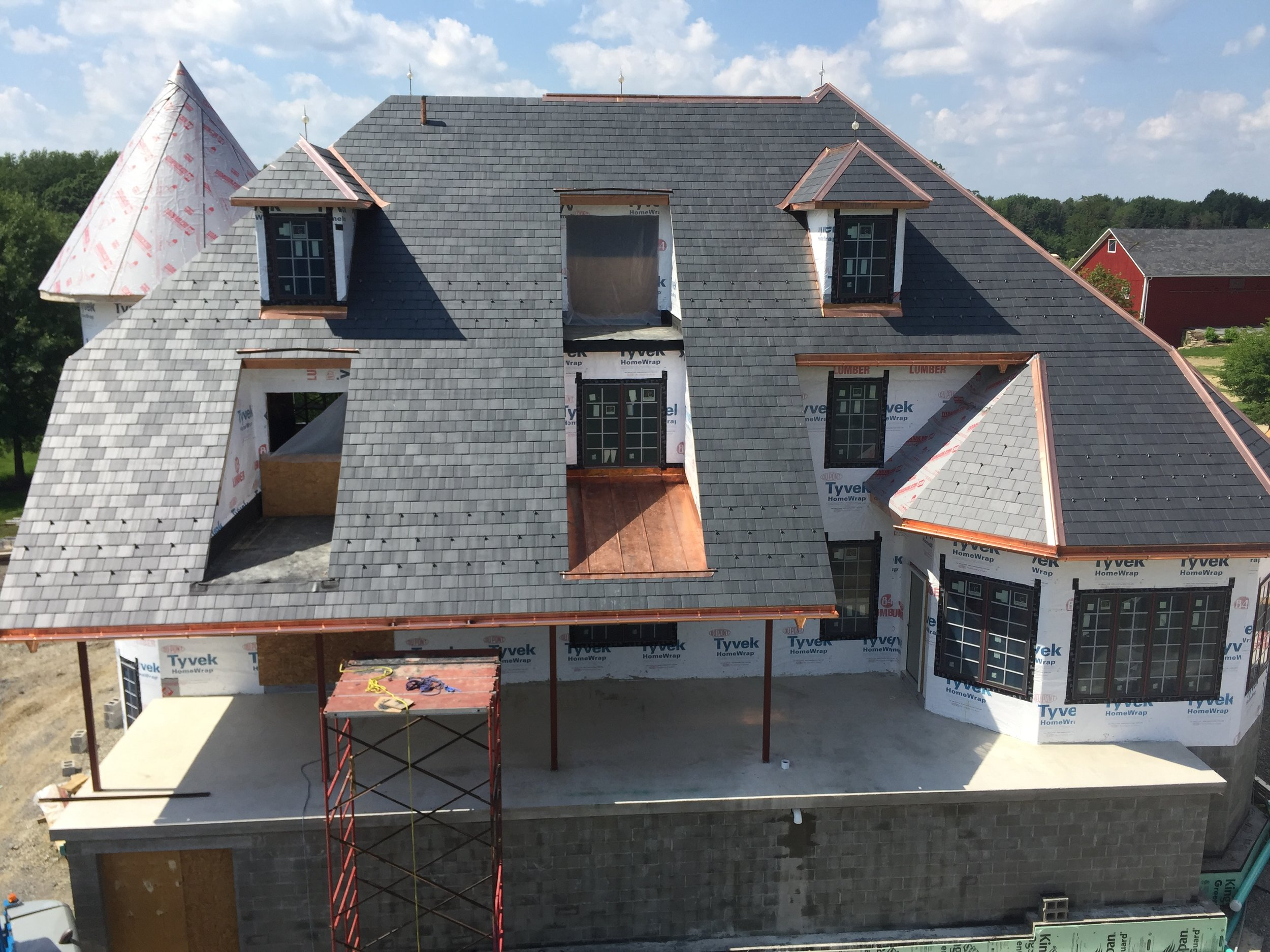 North Country Black Slate - Copper standing seam inset roof and copper ridge, hips, gutter.