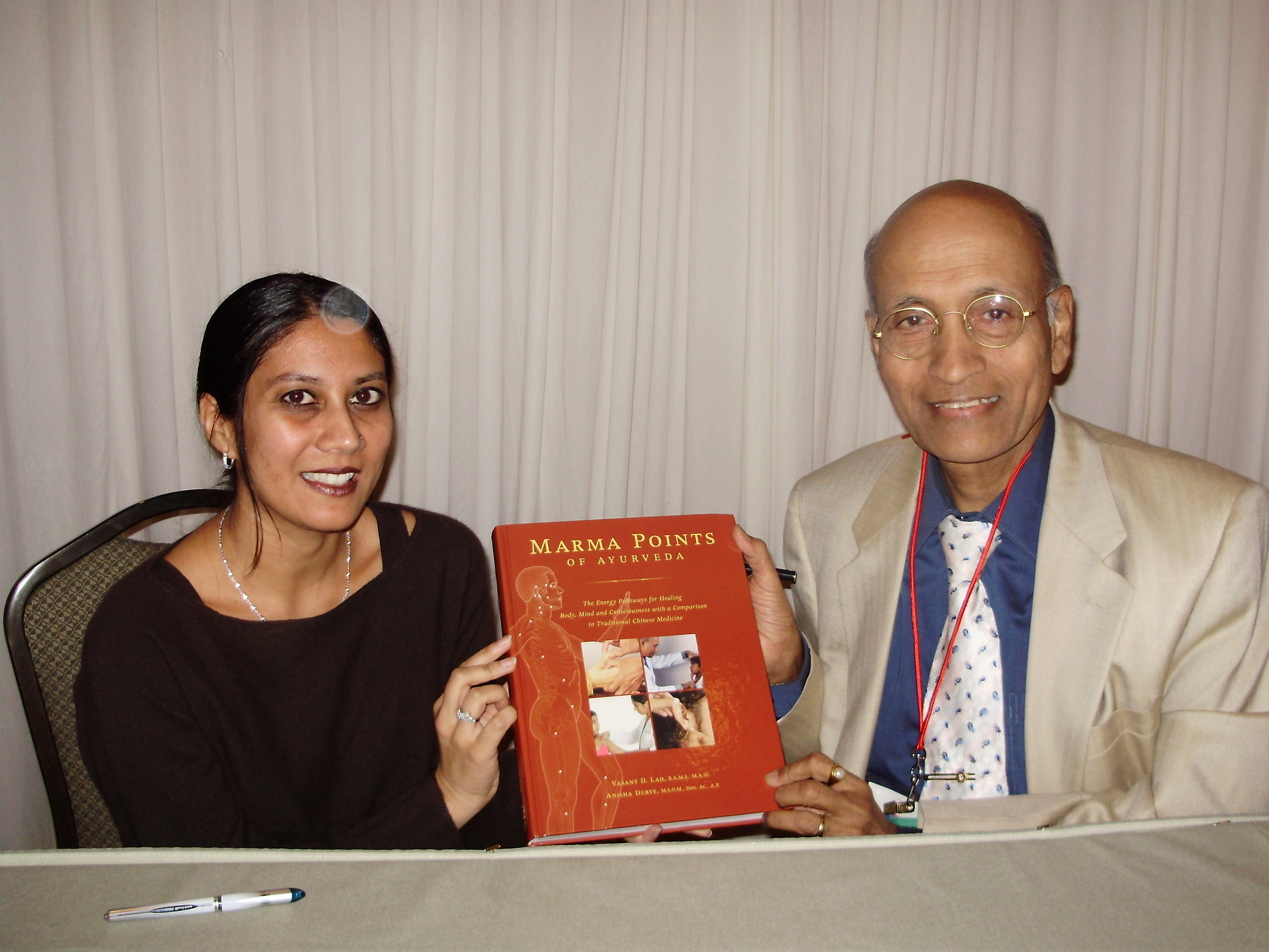 signing marma book with dr. lad.JPG
