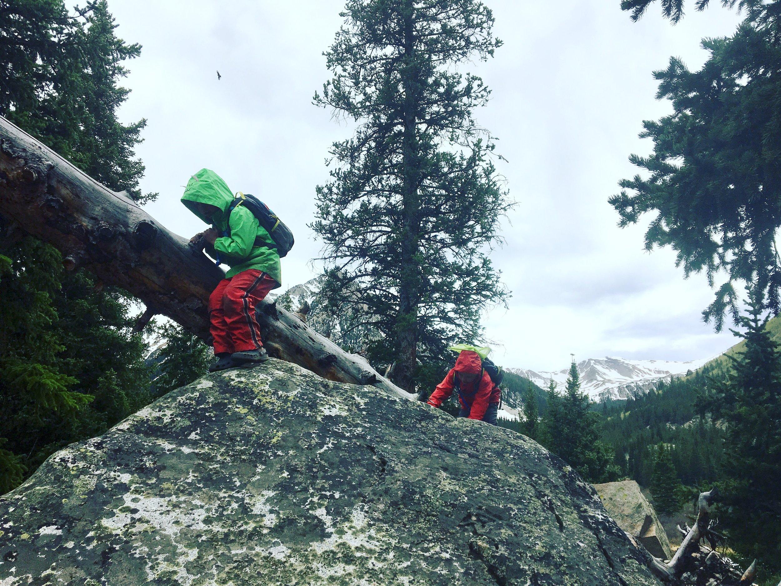 boys climbing rock.JPG