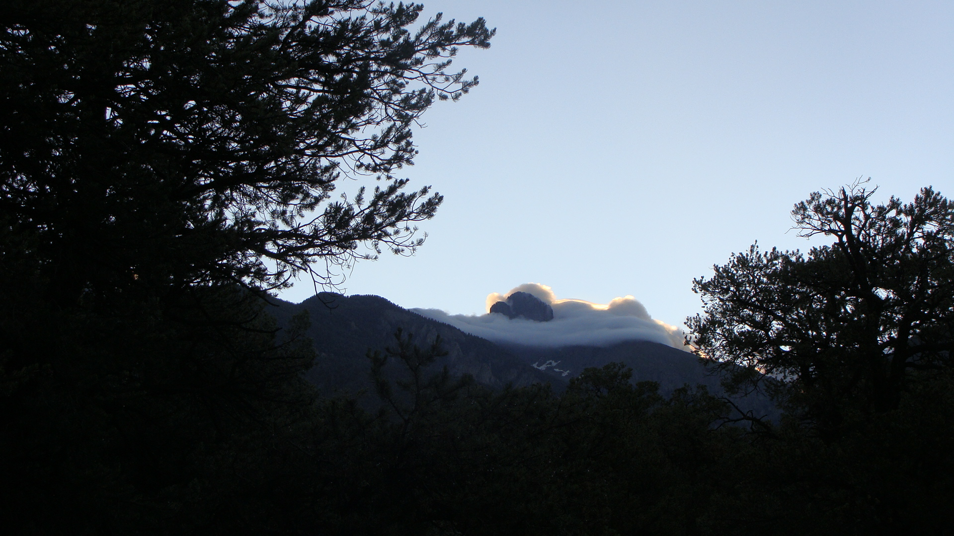 Sometimes clouds obscure part of the mountain ...