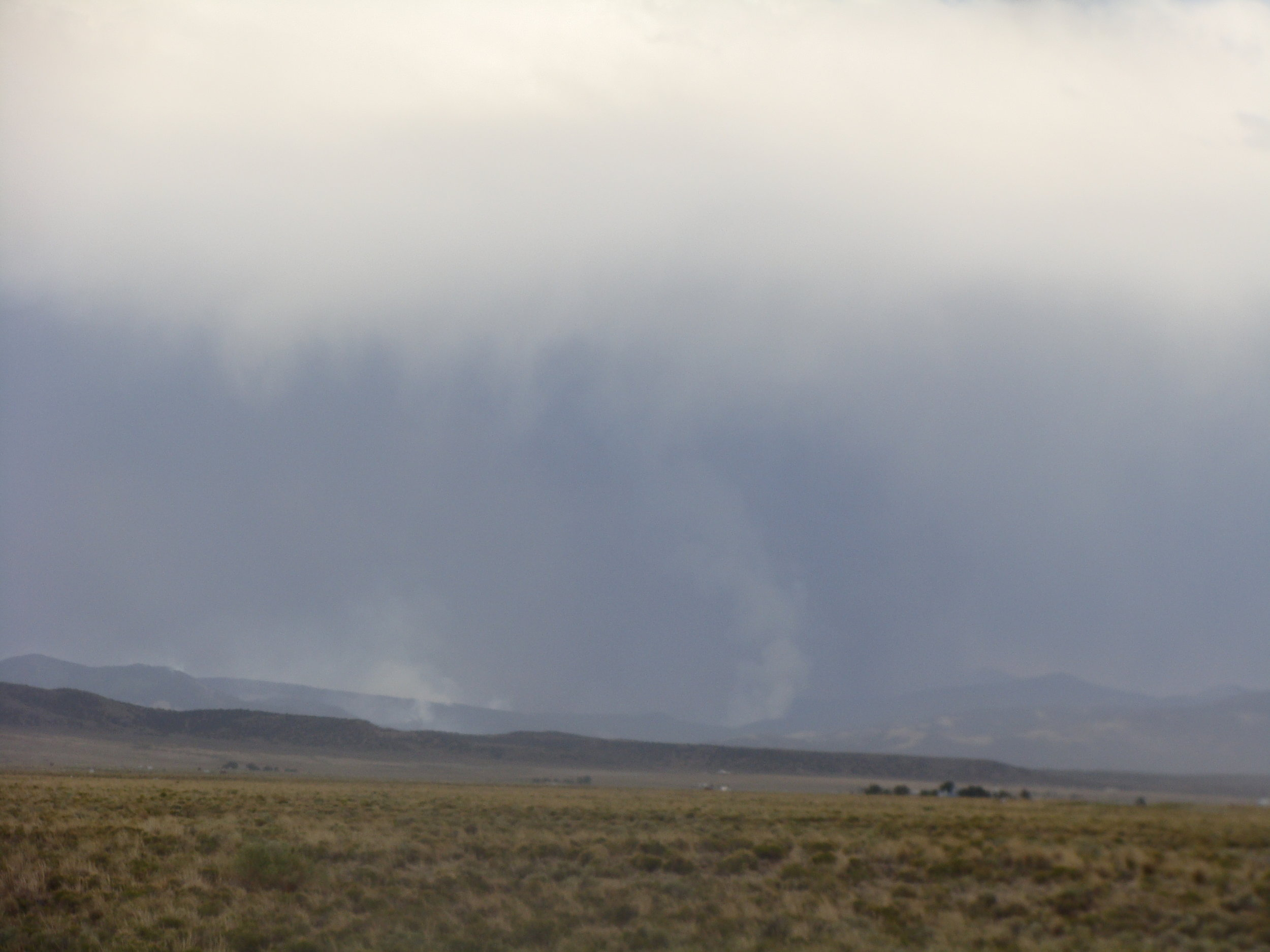 From a distance of 12 miles or so, the fire looks like an afternoon rainstorm. It's not.