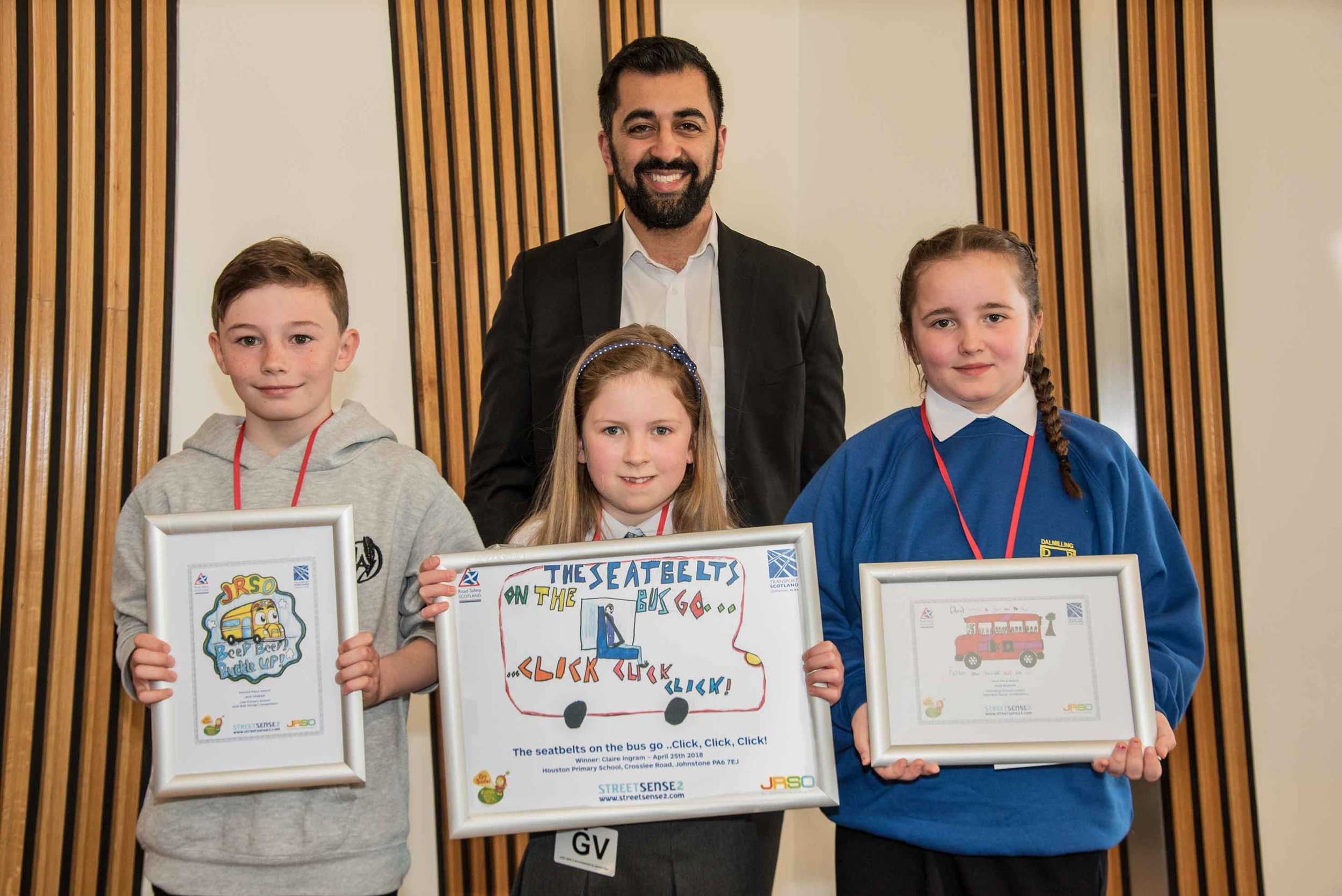 Minister for Transport Humza Yousaf is pictured with the finalists of the Seat Belt Design Competition who are, from left, Jack Parker, who was second, Claire Ingram, who was first, and Dion Benson, who was third. ( click on picture to enlarge)