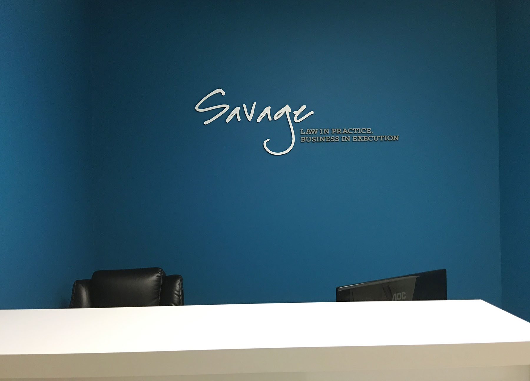 Dimensional Logo: Painted acrylic, mounted to painted drywall