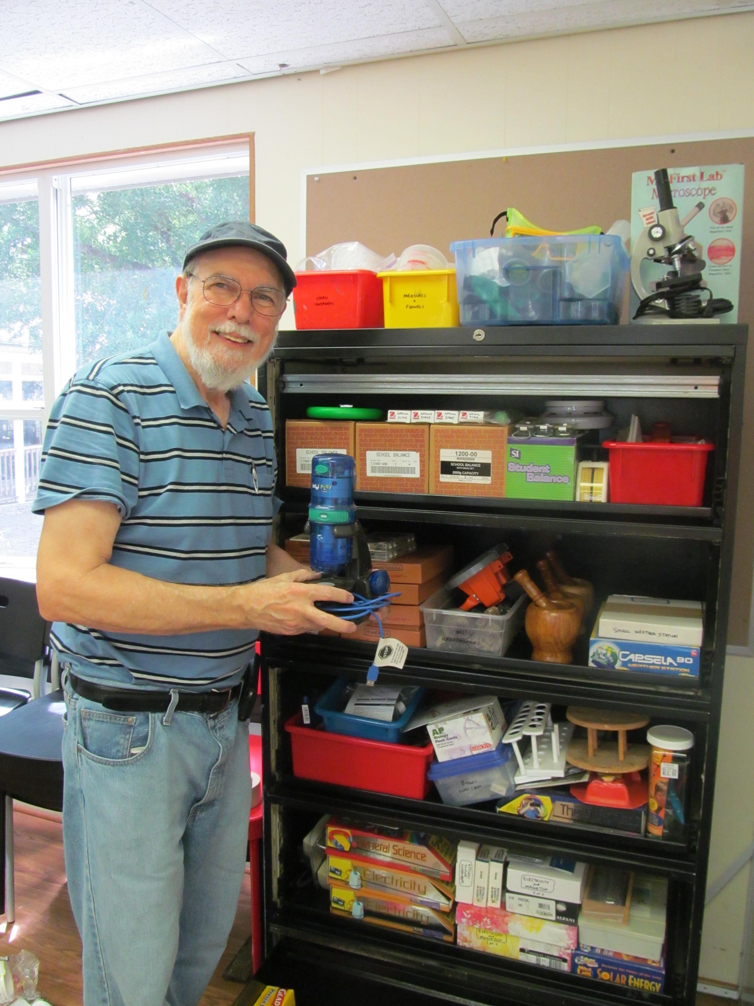 Dr. Bob, community advisor, gets the science lab equipment ready.