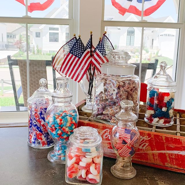 Patriotic treats displayed in my grandpa's antique jars for the fourth.♥️🇺🇸♥️ You can get all of these fun red white and blue candies at the Amish Store in Brigham City. It's such a fun place!