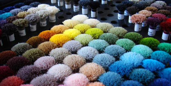 The colors of the poms are the introduction to Distinctive Carpets & Rugs new product line offering various styles of carpeting and area rugs in any color you want and in any width up to 21-feet wide! Larger widths equal less waste and seamless style.