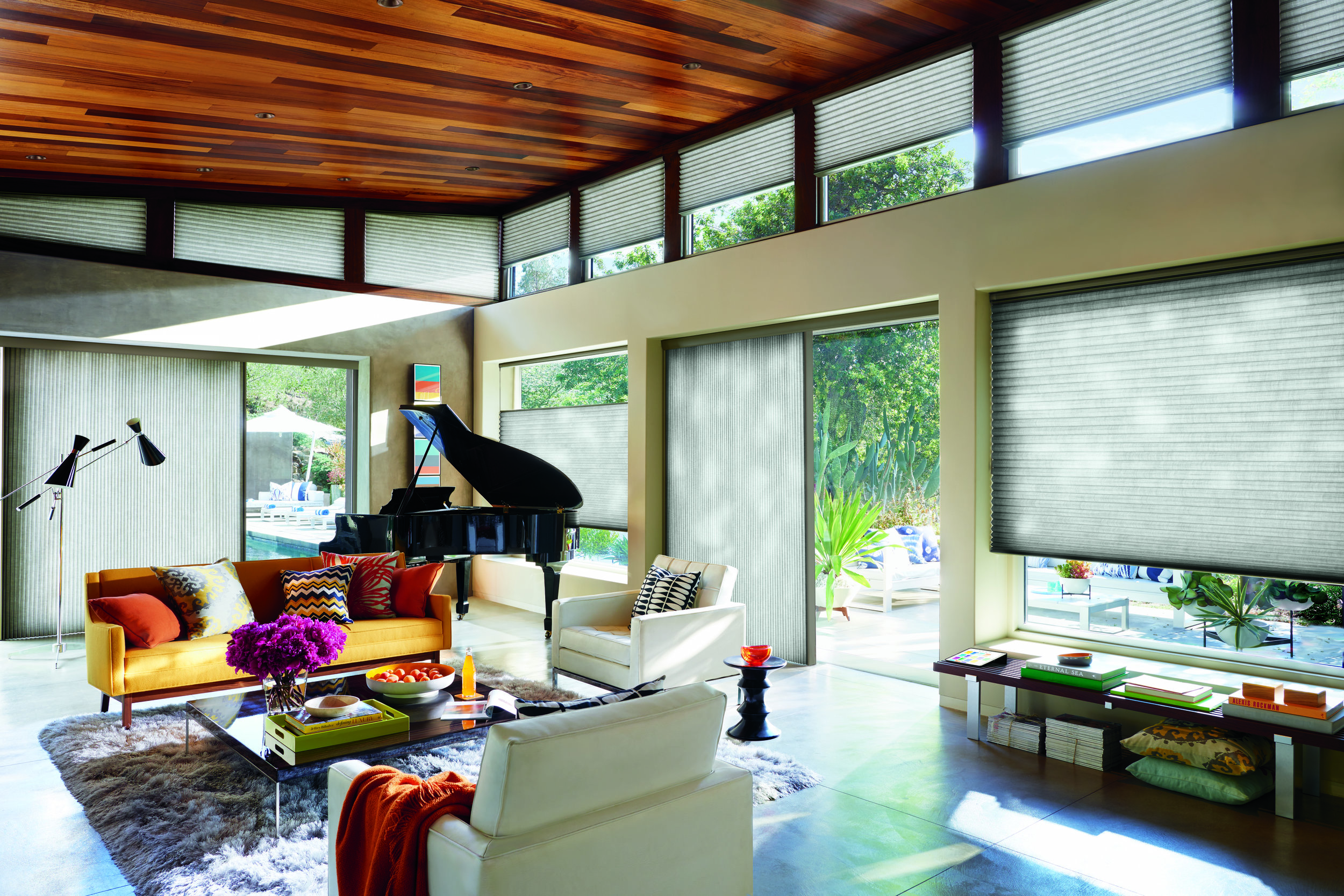 Duette Honeycomb Shades versatility is unsurpassed with specialty shapes: The Vertiglide for sliding patio doors, operational angles and motorization.  One shade for all windows.