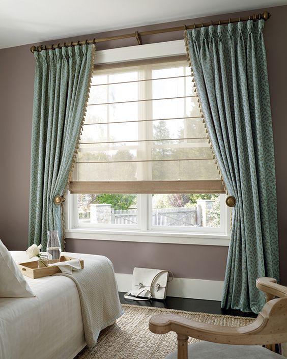 This stunning scene is from Hunter Douglas featuring their Design Studio Roman Shade in Sheer fabric.