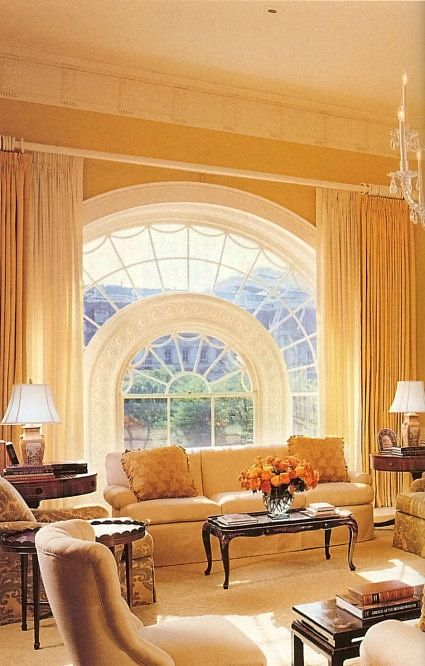 Laura Bush - Photograph 2001. Simple definition.This has to be one of the more popular ways to treat a large arch window today, exposing the architectural elements and preserving the beauty of our window. Of course, today we would extend the drapery to the ceiling.