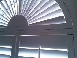 Elliptical Arch - Specialty windows with a perfect arch opening are built for custom elliptical arch shutters. These shutters transform your interior, adding interest and allowing you to control the light with louvers that move.