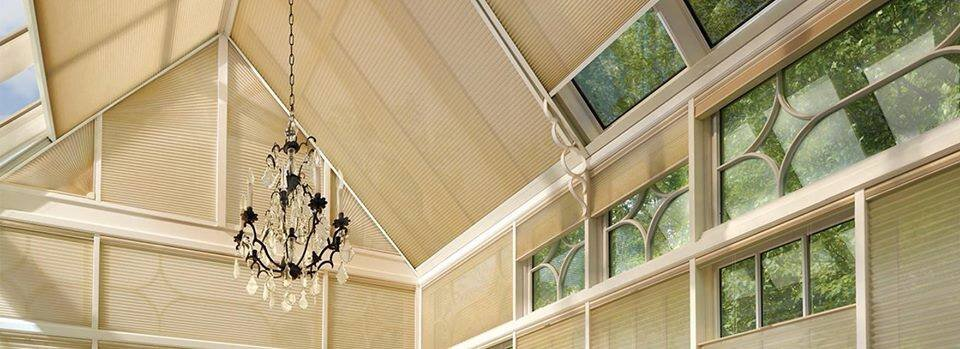 Hunter Douglas Duette honeycomb shades are the perfect fit for specialty windows. For more inspiration on angle-top window coverings click the pic above.