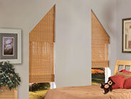 Angle-top woven wood shades have a stationary valance at the shape of the window with the operating shade behind.  The shades can be banded in decorative trims to enhance the look of your decor.