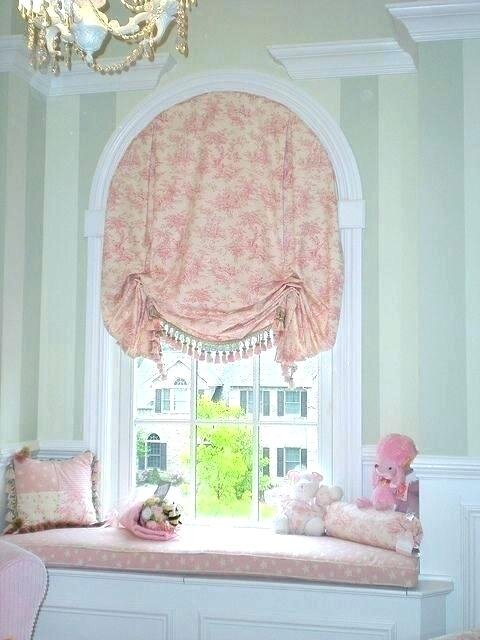 Custom roman shades are a fabulous selection for specialty windows and can be made from a variety of fabric patterns specified by you!  The shade raises up into the arch creating a valance.