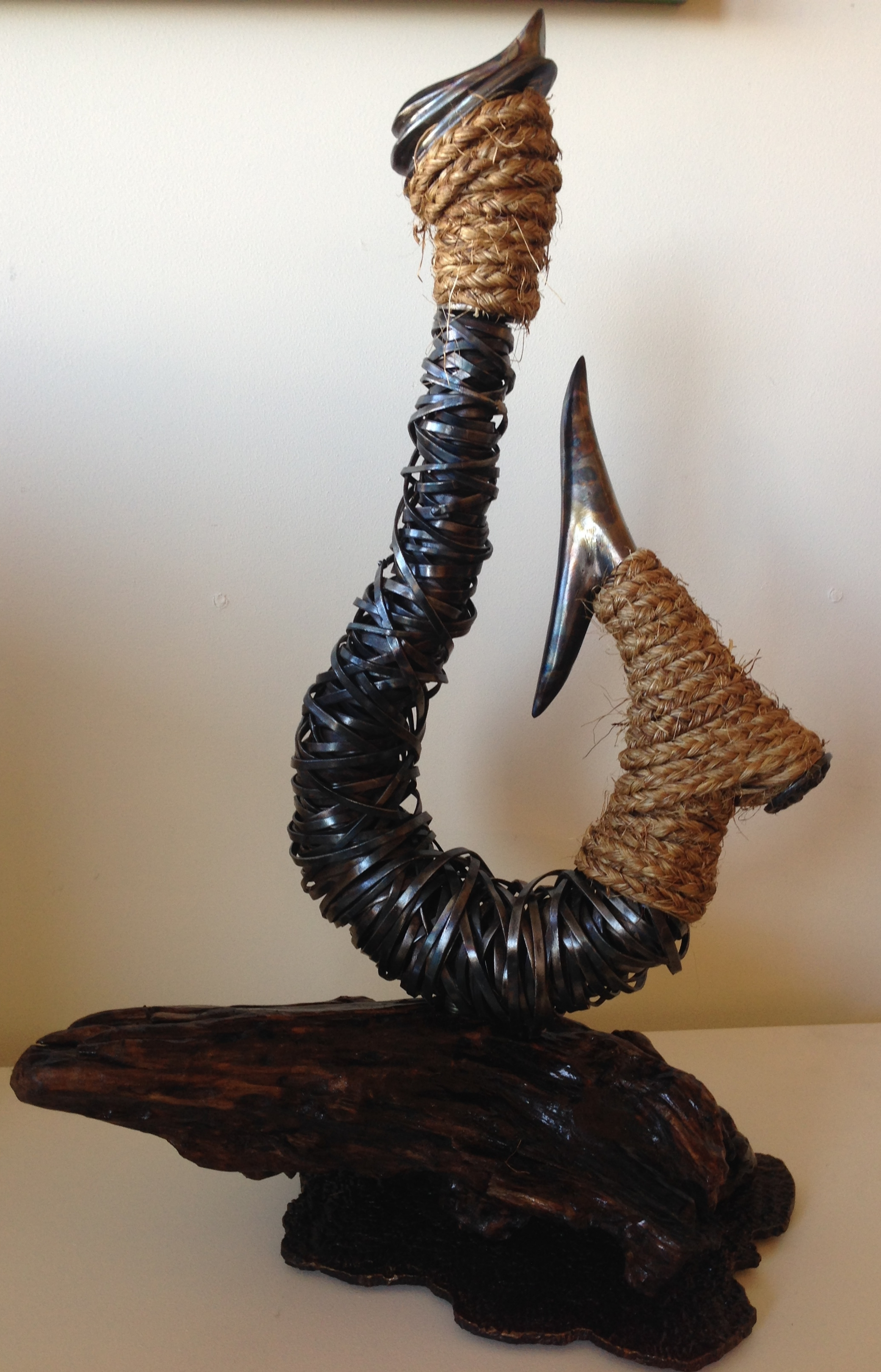 Hook. Steel, copper, wood and rope. By Mark Larsen.
