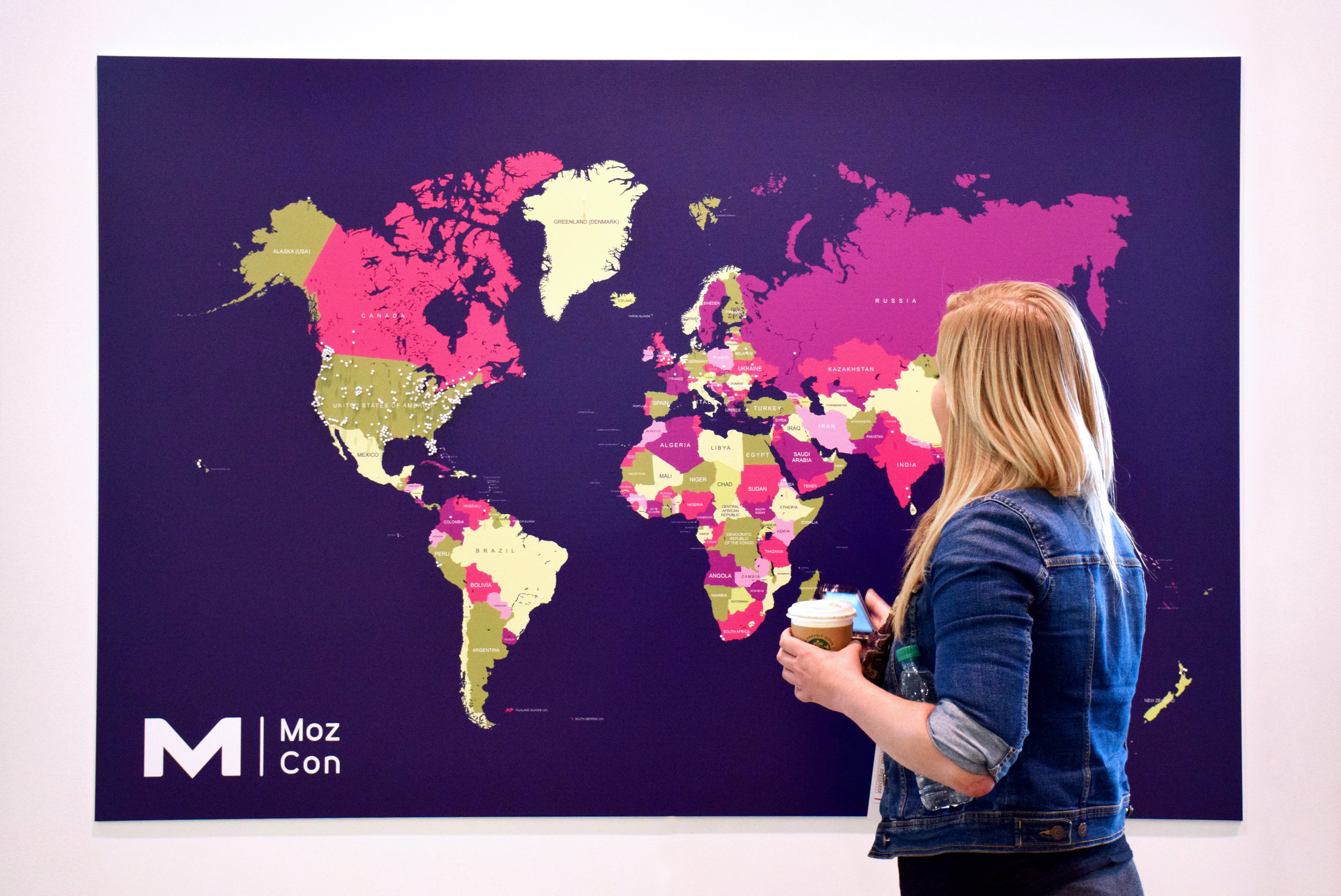 Interactive wall map where conference attendees had the opportunity to mark their place of origin with pushpins.