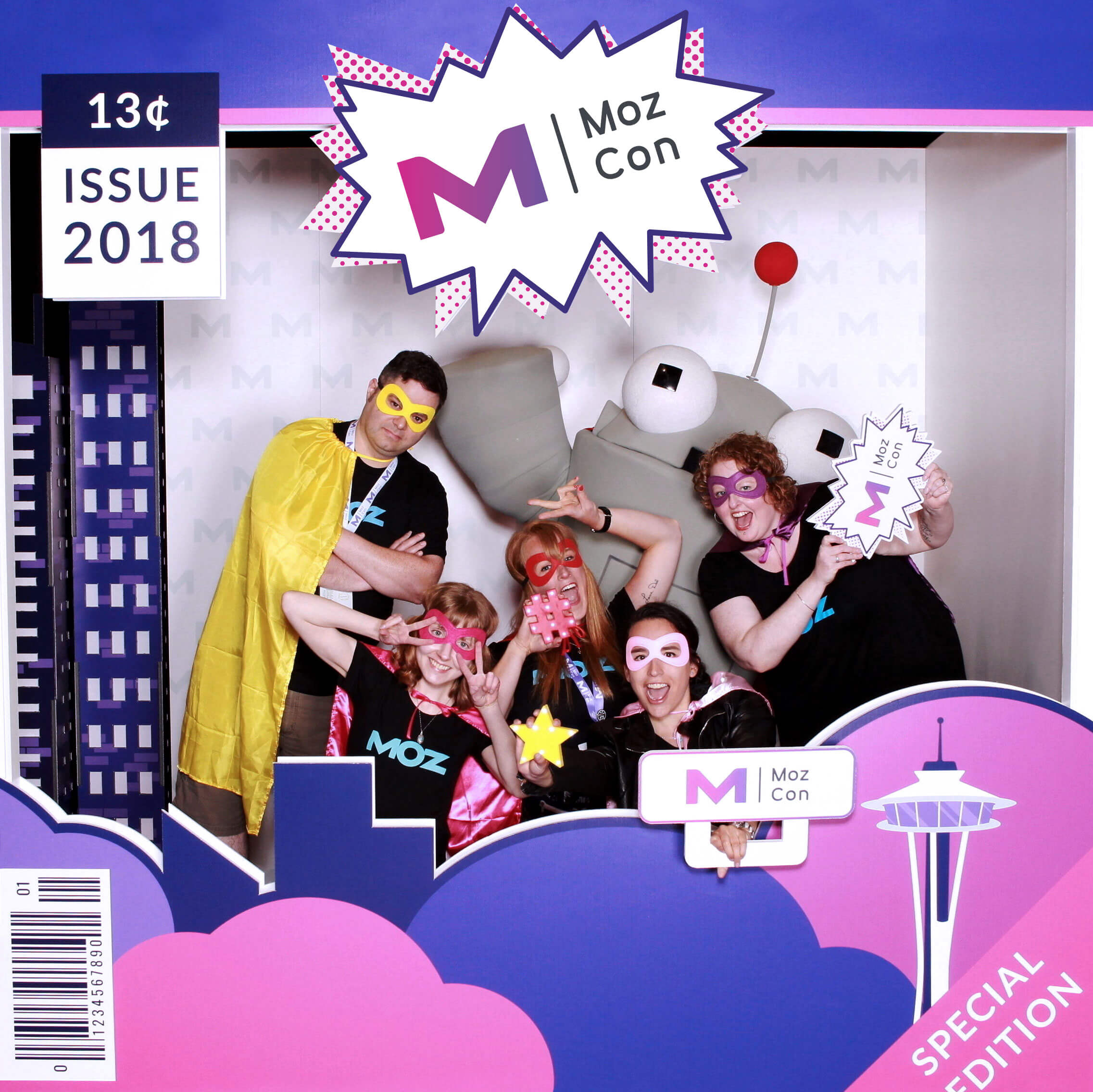 The Moz Design Team having some fun with Super Roger in the comic book-themed photo booth. Photo booth design by me, and photo booth executed with the help of SnapBar.