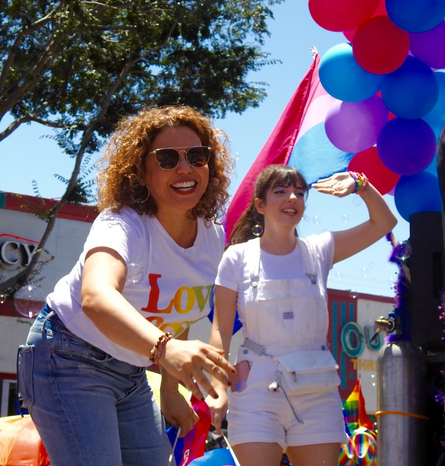 Justina Machado and Sheridan Pierce on the amBi float.