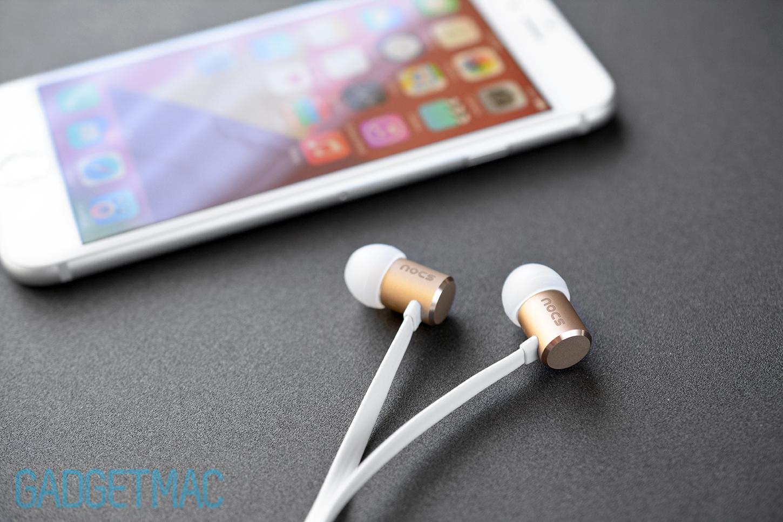 nocs-ns500-aluminum-gold-in-ear-headphones-with-iphone-6.jpg