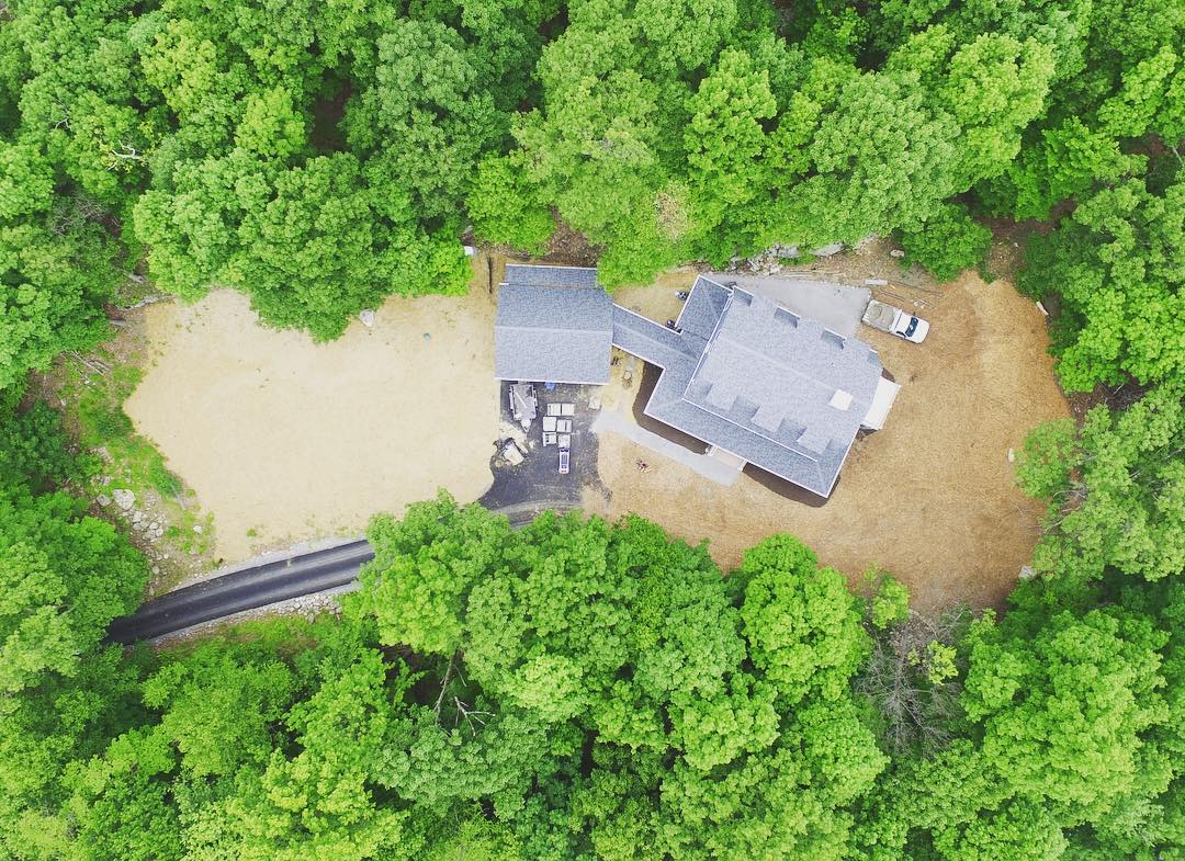 Aerial view of the property. The seeded and strawed meadow is left of the home, the mulched perennial garden is to the right.