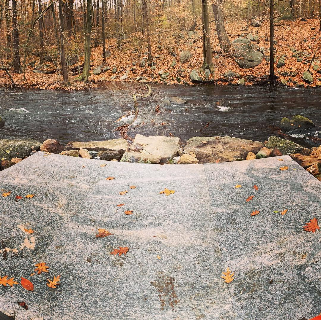 Three, 2200 pound granite slabs set level for a new fishing platform at Mianus River Park