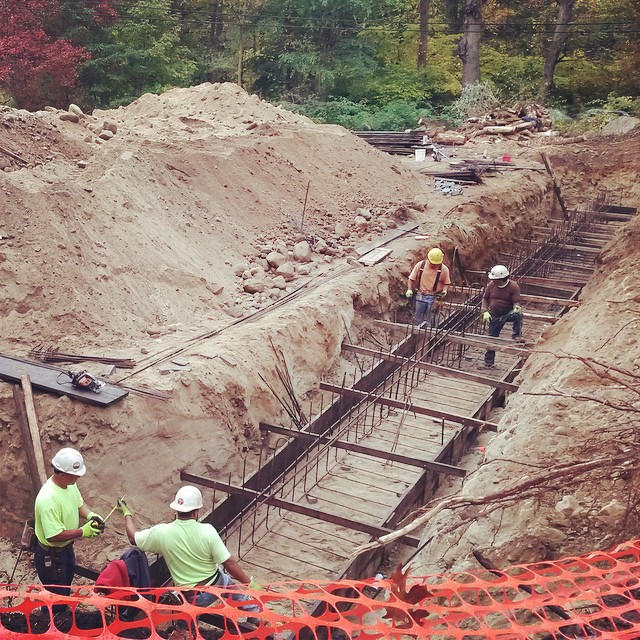 Structural elements being installed for a retaining wall at Mianus River Park
