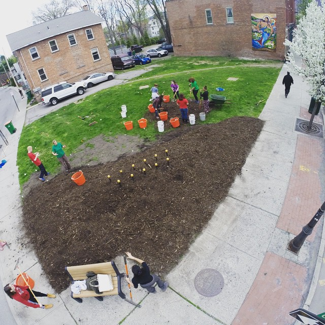 A group of volunteers helping to build a pop up park on main street in Beacon, NY