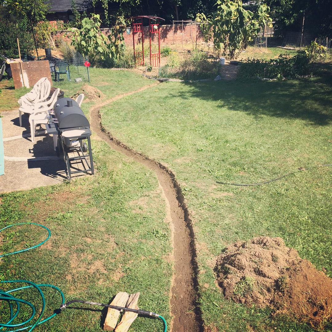 Digging a new rainwater swale to a garden