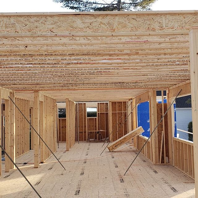 Movin' on up - to the second floor! VERY exciting things happening at #lakesideisthebestside // It's already been a rough winter ❄️ but we are onto framing and getting it done fast over here! #customhomes #residentialconstruction #designdetails #lovewhatyoudo #frameitfastframeitright
