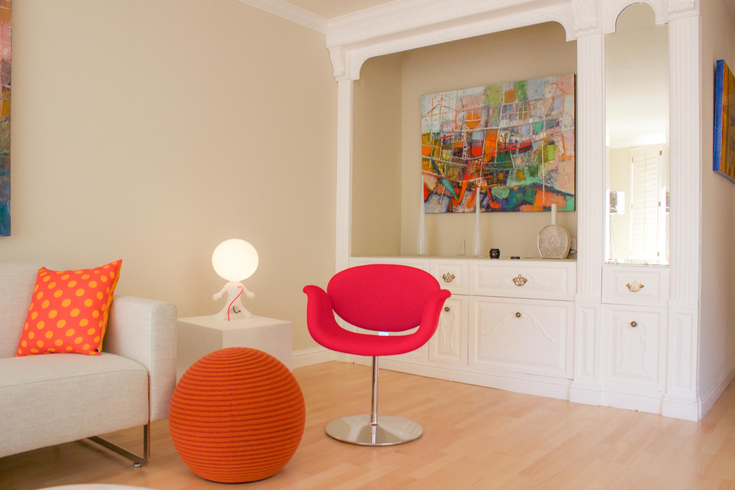 Featuring Montis orange Beanie, Artifort Little Tulip Chair, Dark table light and Mare Sofa.