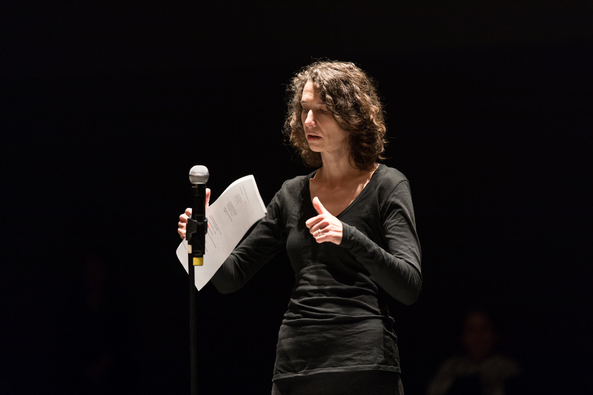 "Photo by Margo Moritz of Frances Richard reading her ""Locus Poem."""