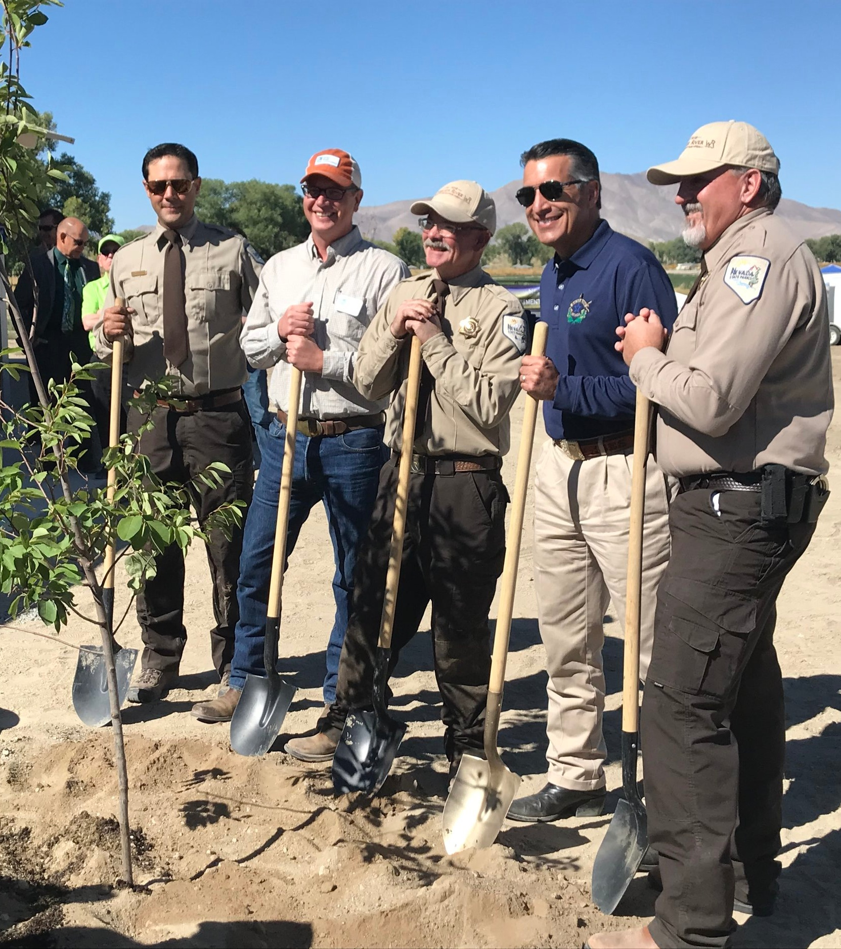 Planting a tree during the Walker River State Recreation Area ribbon cutting.
